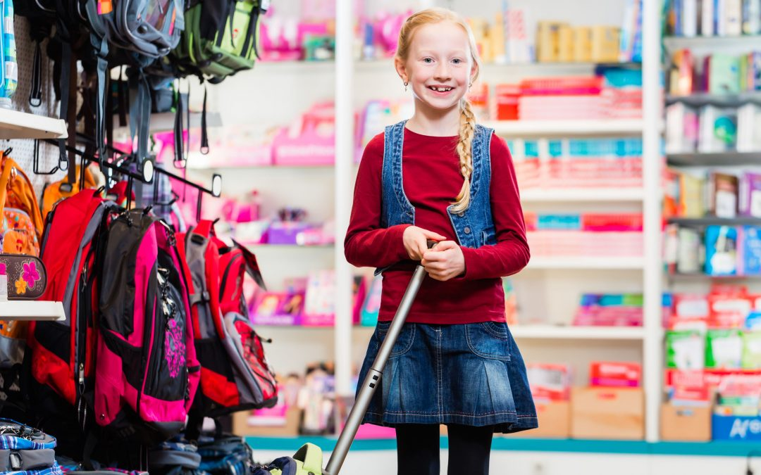 Girl student shopping for backpacks and school supplies