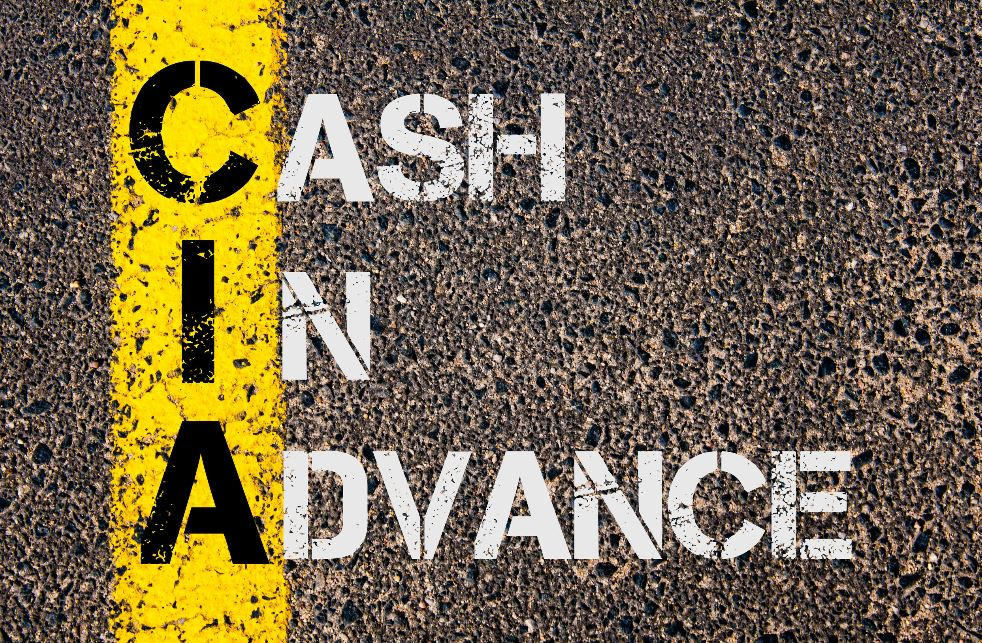 Cash In Advance Painted on Road