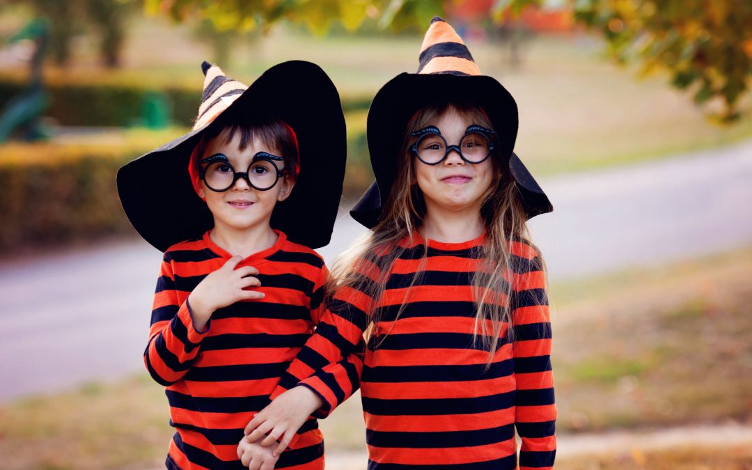 boy and girl in the park in halloween costumes