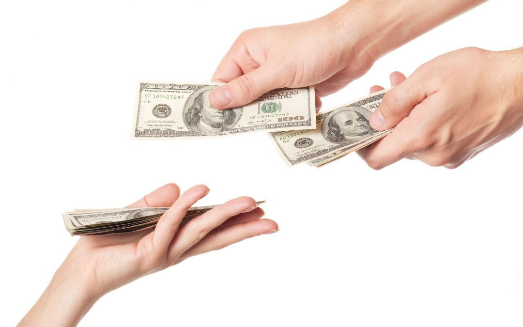 Two hands exchanging money