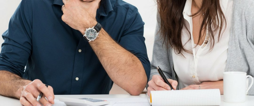 couple working a new year budget to avoid using a title loan